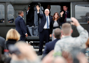 U.S. Vice President Mike Pence and his wife Karen wave before boarding the Air Force Two at Yokota U.S. Air Force Base in Fussa
