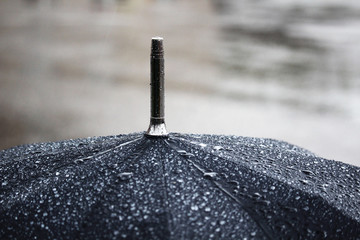 A black umbrella under rain