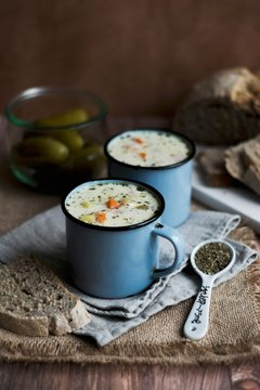 Gherkin soup in enamel mugs