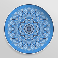 Beautiful decorative plate with round mandala. Blue ornament in ethnic style.