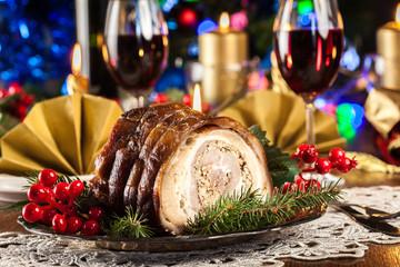 Traditional italian porchetta on festive table
