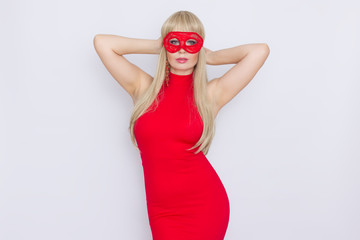 Woman in red dress put carnival mask over white background