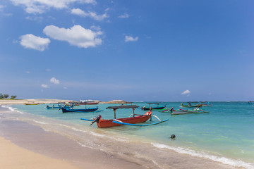 Traditional Balinese fishing boats at the beach of Kuta. Indonesia