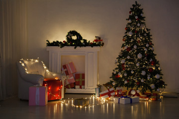 Christmas tree with lights light Garland and gifts for the new year