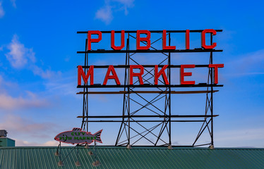 Pike Place Market neon sign with a blue sky in the background Seattle Washington