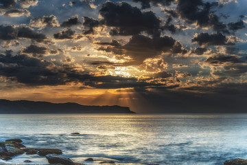 Seascape with Sun Rays through the Clouds