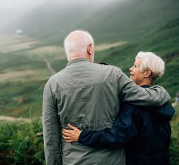 Happy senior couple enjoying a breathtaking view