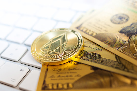 Golden EOS.IO and US dollar banknote. Digital cryptocurrency concept