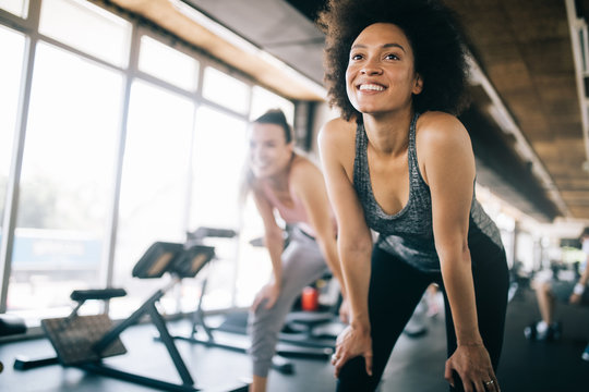 Fit sportswoman exercising and training at fitness club