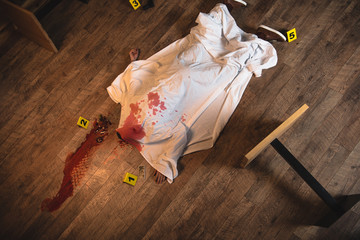 top view dead body covered with white sheet at crime scene - fototapety na wymiar