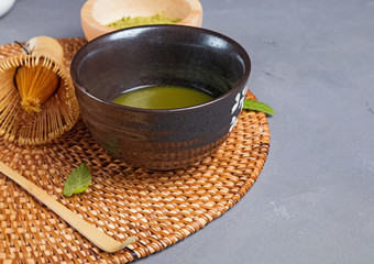 Wall Mural - Matcha tea in a traditional bowl close-up.