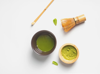 Wall Mural - Matcha tea in a traditional bowl, whisk and powder