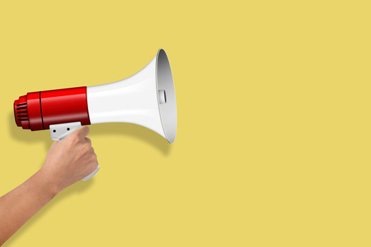 Hand Hold Megaphone isolated on yellow background