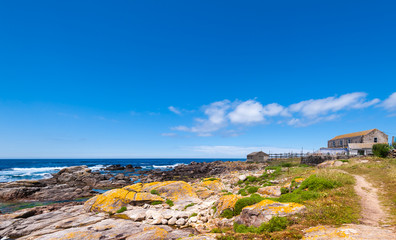 Landscape with sea,cliff, beach and blue sky. Galicia Spain.