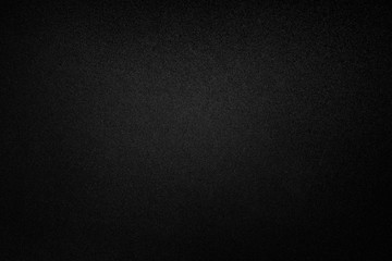 Black paper texture or background.