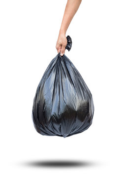 hand hold garbage bag isolated on white