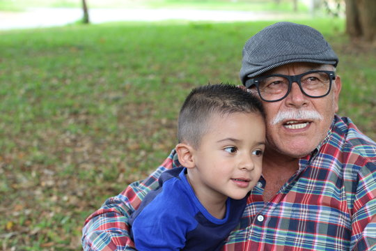 Grandpa telling stories to grandson