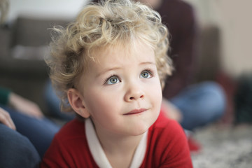 Portrait of a sweet baby with blue eyes and blond curly hair