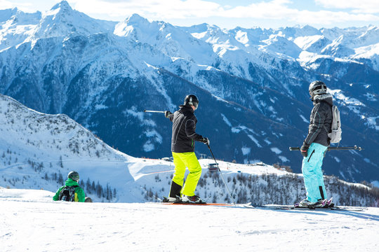 Active family skiing with a child on a mountain slope