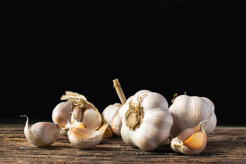 Closeup garlic on wooden texture on for cooking on dark background Wall mural