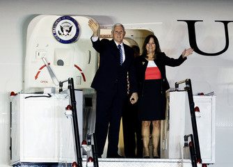 U.S. Vice President Mike Pence and his wife Karen arrive for the ASEAN Summit at Paya Lebar Air Base in Singapore