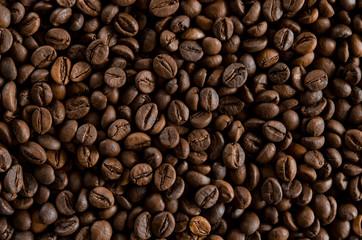Roasted coffee beans as backgroundon the table