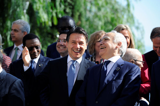 Italy's Prime Minister Giuseppe Conte and U.N. Envoy to Libya Ghassan Salame smile as they pose for a family photo during the second day of the international conference on Libya in Palermo