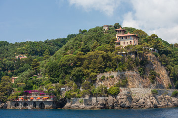 Buildings on the cliffs overlooking the beautiful harbour at Portofino on the  Ligurian coast, Italy