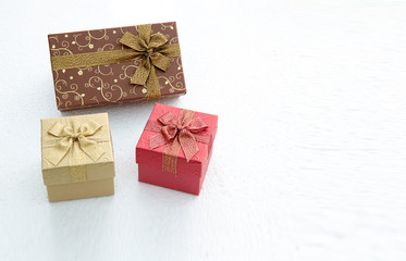 Christmas gift box - Vintage effect style pictures.gift box on white table. colorful gifts box.Golden gift boxes on abstract background.Christmas miracle, magic gift box.