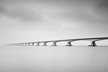 The Zeelandbrug (Zeeland Bridge) in the Dutch province of Zeeland, photographed in black & white, long exposure shot. Fototapete