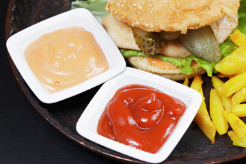 Sauces and hamburger with breast cutlet