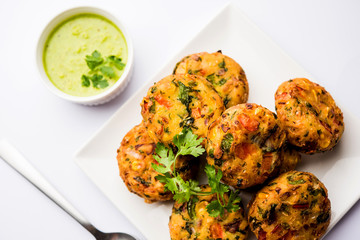 Crispy Corn Tikki, pakora/pakoda or pattice also known as cutlet. served with green chutney. Selective focus
