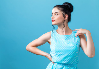 Beautiful fashionable young woman on a blue background