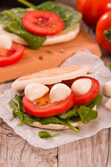 Tigella bread with spinach and tomatoes.