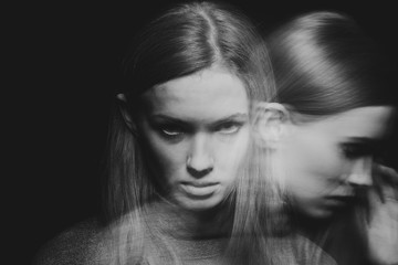 Back and white multiple exposure of beautiful young woman with mood disorder