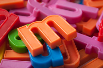 closeup of colorful plastic letters on full frame