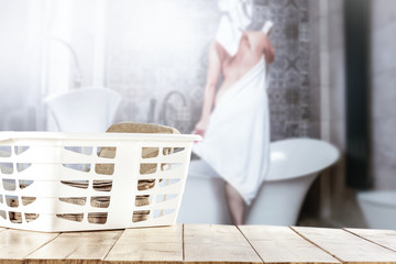 Table of free space for your decoration and blurred background of free space of woman in bathroom