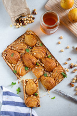 Pear tart with hazelnuts and honey