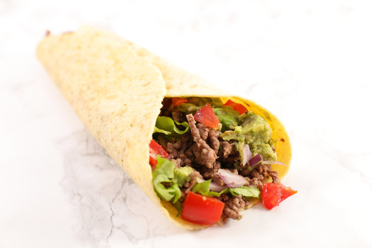 tortilla with minced beef, avocado and tomato