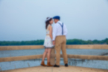 pre wedding sceen out door tree background.,asian lover ,Blur of pre wedding photo, soft beautiful. pre wedding couple happy man and woman