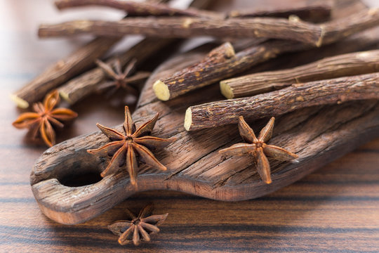 licorice root and anise on the table - Glycyrrhiza glabra