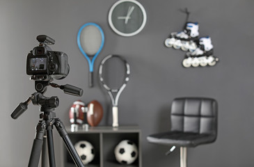 Workplace for blogger with camera and sportive equipment indoors