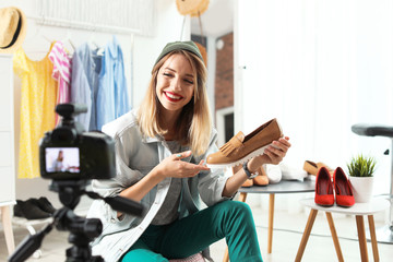 Fashion blogger recording video on camera at home