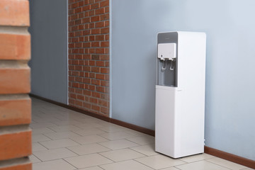 Modern water cooler in office hall