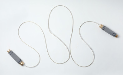 Jump rope on white background, top view
