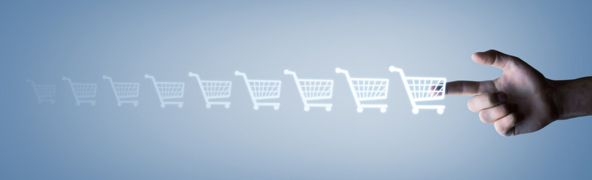 Male hand pressing shopping cart icon. Concept of shopping