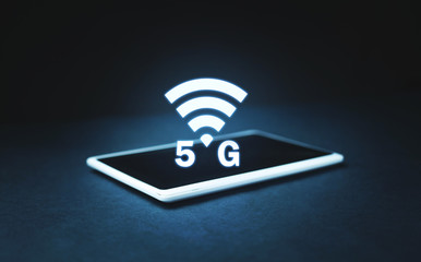 5G Internet on tablet. Internet speed and communication concept
