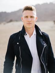 Handsome man in jacket posing