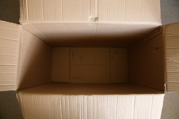 A top view of an empty cardboard box. Packaging and shipping concept image.