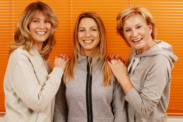 Three happy mature woman with different age together